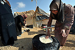 A woman cooks bread over a stove in the Zaatari Refugee Camp, located near Mafraq, Jordan. Opened in July, 2012, the camp holds upwards of 50,000 refugees from the civil war inside Syria. International Orthodox Christian Charities and other members of the ACT Alliance are active in the camp providing essential items and services.