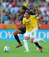 Shannon Boxx (l) of team USA and Marta of team Brazil during the FIFA Women's World Cup at the FIFA Stadium in Dresden, Germany on July 10th, 2011.