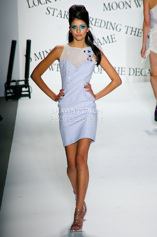 Model walks the runway in an outfit by Richie Rich, for the POPLUXE by Richie Rich Spring 2011 fashion show, during Mercedes-Benz Fashion Week, September 9, 2010.