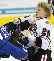 Rockford Icehogs' Rob Flick, right, fights with San Antonio Rampage's Eric Selleck during the first period of an AHL hockey game, Saturday, Jan. 14, 2012, in San Antonio. (Darren Abate/pressphotointl.com)