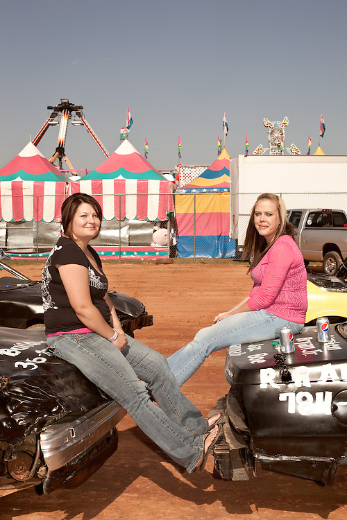October 20, 2012. Raleigh, North Carolina.. (left to right) Jenny Sykes and Ashley Moser await the beginning of the State Fair figure eight races. Their husbands, Bryan Sykes and Ronald Moser were the top 2 qualifiers for the final. . Ronald Moser, the reigning champion,  won the #2 spot.