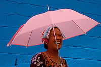 Women from Chuuk with pink Umbrella