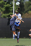 09 September 2012: Duke's Callie Simpkins (behind) heads the ball over Marquete's Taylor Madigan (15). The Duke University Blue Devils defeated the Marquette University Golden Eagles 5-2 at Koskinen Stadium in Durham, North Carolina in a 2012 NCAA Division I Women's Soccer game.