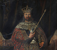 Detail of the portrait of King Manuel I or Emmanuel I, known as the Manuel the Fortunate or Manuel o Afortunado, 1469-1521, 14th King of Portugal, in the Great Room of Acts, or Sala dos Capelos, or Red Room, decorated in the 17th century by master builder Antonio Tavares and reworked in the 18th century, at the University of Coimbra in the royal palace or Paco Real, Coimbra, Portugal. The University of Coimbra was first founded in 1290 and moved to Coimbra in 1308 and to the royal palace in 1537. The buildings are listed as a historic monument and a UNESCO World Heritage Site. Picture by Manuel Cohen