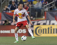 New York Red Bulls midfielder Eric Alexander (12) at midfield. In a Major League Soccer (MLS) match, the New England Revolution (blue) tied New York Red Bulls (white), 1-1, at Gillette Stadium on May 11, 2013.
