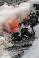 Lava flowing from Kilauea Volcano spills into the crashing surf off the Hilo coastline of Hawai'i Island.