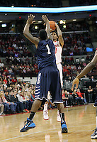 Ohio State's LaQuinton Ross (10) shoots over North Florida's Travis Wallace (1) during the first half Friday, Nov. 29, 2013, in Columbus, Ohio. (Photo by Terry Gilliam)