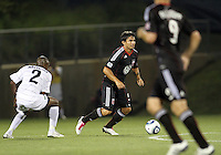 Jaime Moreno #99 of D.C. United moves past Mpho Moloi #2 of the Harrisburg City Islanders during a US Open Cup match at the Maryland Soccerplex on July 21 2010, in Boyds, Maryland. United won 2-0.