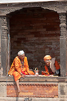 Pashupatinath, Nepal.  Sadhus, Hindu Ascetics, Rest Inside a Pati, an Open-air Resting Place.