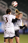 3 November 2006: Wake Forest's Kristen Kemp (10) catches an elbow from Florida State's Onnie Trusty (3) while both battle for a header. Florida State defeated Wake Forest 4-2 in penalty kicks after playing to a 0-0 draw after overtime at SAS Soccer Park in Cary, North Carolina in an Atlantic Coast Conference women's college soccer tournament semifinal game.