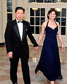 Chris Lu, Assistant to the President and Cabinet Secretary, and Katie Thomson arrive for the Official Dinner in honor of Prime Minister David Cameron of Great Britain and his wife, Samantha, at the White House in Washington, D.C. on Tuesday, March 14, 2012..Credit: Ron Sachs / CNP.(RESTRICTION: NO New York or New Jersey Newspapers or newspapers within a 75 mile radius of New York City)