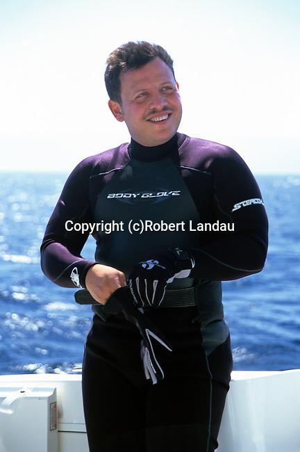 King Abdullah II of Jordan preparing to dive from his boat in Aqaba, Jordan