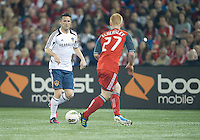 07 March 2012: LA Galaxy forward Robbie Keane #7 and Toronto FC defender Richard Eckersley #27 in action during a CONCACAF Champions League game between the LA Galaxy and Toronto FC at the Rogers Centre in Toronto..The game ended in a 2-2 draw.