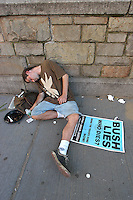 NEW YORK, NY - August 29, 2004: A passed out protester lies on the sidewalk.