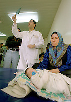 (February 1998) Pediatrician , doctor Yaser Raouf, at the Saddam Hospital in Baghdad is looking at x-ray of a orphan child found in a street and taken to the hospital. <br /> Due to UN sanctions the hospital was lacking many medicines, and the civilians suffered due to lack of food as well. <br />  Former U.N. Humanitarian Coordinator in Iraq Denis Halliday estimated the resulting deaths : &quot;Two hundred thirty-nine thousand children 5 years old and under&quot; as of 1998.<br /> <br /> The sanctions against Iraq were a near-total financial and trade embargo imposed by the United Nations Security Council on the Iraqi Republic.<br /> <br /> <br /> &copy;Fredrik Naumann/Felix Features