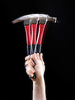 MOMENT OF INERTIA: WAVING A HAMMER (1 of 2)<br /> Hammer Held At Handle End<br /> Most of the hammer's mass is in the head. When it is held by the handle, the mass is located further from the axis and it will have a greater moment of inertia.  It is much harder to swing the hammer.