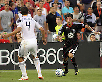 Santino Quaranta #25 of D.C. United moves up against Omar Gonzalez #4 of the Los Angeles Galaxy during an MLS match at RFK Stadium on July 18 2010, in Washington D.C. Glaxy won 2-1.