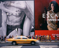 """Out takes from """"The Harvard Design School Guide to Shopping"""" published by Tashen. Crowds walk down Broadway in front of massive advertisements that cover-up construction projects. New York 2000"""