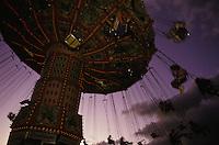 A carnival ride at dusk at the annual Hawaii State Farm Fair on Oahu