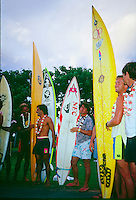 Michael Ho (HAW), Ross Clarke Jones (AUS), Gary 'Kong' Elkerton (AUS) and Buzzy Kerbox (HAW) at the opening ceremony of the Quiksilver Eddie  Aikau Big Wave Invitational at Wiamea Bay on Oahu's North Shore in the late 80's. circa 1988. Photo: joliphotos.com