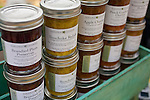 The Portland Farmers' Market in the South Park Blocks on Saturday mornings.  Sassafras Catering started canning their chutneys.  Employee William Cheek presiding over the morning market.  Tricia Butler is the proprietor and works to make all the recipes.  The Sunchoke Relish is a recipe from the South that is over 100 years old.