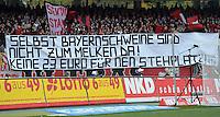 FUSSBALL   1. BUNDESLIGA  SAISON 2012/2013   8. Spieltag 1. FC Nuernberg - FC Augsburg       21.10.2012 Fankurve vom 1 FC Nuernberg mit einem Banner, SELBST BAYERNSCHWEINE SIND NICHT ZUM MELKEN DA, KEINE 23 EURO FUER NEN STEHPLATZ