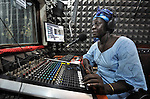 "Melania Itto, the program manager of Radio Bakhita, hosts the morning ""Juba Sunrise"" program in the station's studio in Juba, the capital of Southern Sudan."