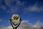 Coin operated binocular with clouds and blue sky Seattle Washingotn State USA