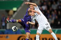 FUSSBALL   DFB POKAL   SAISON 2011/2012  1. Hauptrunde VfL Osnabrueck - TSV 1860 Muenchen                29.07.2011 Nils FISCHER (li, Osnabrueck) gegen Stefan AIGNER (re, Muenchen)