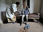 A nurse checks on a patient in the United Methodist hospital in the Congolese village of Tunda.