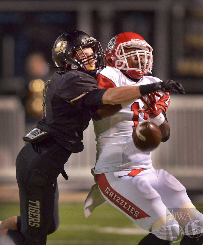 STAFF PHOTO BEN GOFF  @NWABenGoff -- 10/03/14 Hayden McDaniel, left, Bentonville defensive back, breaks up a pass intended for Tyler Triplett, Fort Smith Northside wide receiver, to force a fourth down during the second quarter of the geme in Bentonville's Tiger Stadium on Friday October 3, 2014.