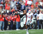 Ole Miss' Donte Moncrief (12) catches a touchdown pass from Ole Miss quarterback Randall Mackey (1) at Vaught-Hemingway Stadium in Oxford, Miss. on Saturday, September 24, 2011. Georgia won 27-13.