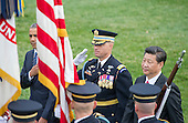 United States President Barack Obama and President XI Jinping of China review the troops during an official State Arrival ceremony on the South Lawn of the White House in Washington, DC on Friday, September 25, 2015.<br /> Credit: Ron Sachs / CNP