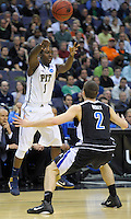 Travon Woodal dishes off the ball to a teammate. Pittsburgh defeated UNC-Asheville 74-51 during the NCAA tournament at the Verizon Center in Washington, D.C. on Thursday, March 17, 2011. Alan P. Santos/DC Sports Box