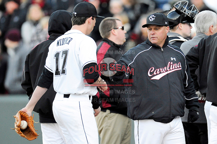 Pitcher Taylor Widener (17) of the South Carolina Gamecocks is congratulated by head coach Chad Holbrook (2) after picking up the save in the Reedy River Rivalry game against the Clemson Tigers on Saturday, February 28, 2015, at Fluor Field at the West End in Greenville, South Carolina. South Carolina won, 4-1. (Tom Priddy/Four Seam Images)