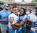 North Carolina kicker Nick Weiler, center, celebrates his game winning field goal with quarterback Mitch Trubisky after defeating Florida State 37-35 in an NCAA college football game in Tallahassee, Fla., Saturday, Oct. 1, 2016.  (AP Photo/Mark Wallheiser)