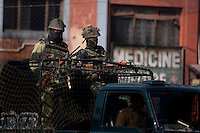 Indian army soldiers on a truck pass through the center of Srinagar as paramilitary police enforce a curfew imposed to stop separatists gather for a political demonstration in Srinagar, Kashmir, India.  Fredrik Naumann/Felix Features