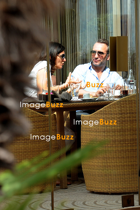 Jean Dujardin  and an unknown woman are enjoying a lunch at the Martinez Hotel..May 22 n, 2012..Exclusive photos!.