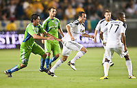 Seattle Sounders defender Leo Gonzalez (19) tries to slow down LA Galaxy midfielder Landon Donovan (10) during the second half of the game between LA Galaxy and the Seattle Sounders at the Home Depot Center in Carson, CA, on July 4, 2010. LA Galaxy 3, Seattle Sounders 1.