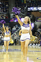 December 22, 2013:  Washington cheerleader Hannah Tripp entertained fans during a timeout against Connecticut.  Connecticut defeated Washington 82-70 at Alaska Airlines Arena Seattle, Washington.