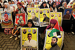 Families of Palestinian prisoners in the weekly sit-in to calling for the release of Palestinian prisoners from Israeli jails in front of the Red Cross in Gaza City, on Sep. 30, 2013. Photo by Mohammed Asad
