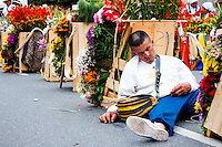 A man take a nap before to start  the 58th Silleteros' parade in the framework of the flowers' fair, this year the parade was declared intangible heritage of Colombia. Medellín, Colombia 09/08/2015