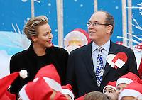 Princess Charlene of Monaco and Prince Albert attend the Children's Christmas Ceremony - Monaco