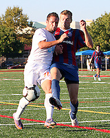 Andrew Marshall #5 of Crystal Palace Baltimore tackles Daniel Paladini #11 of the Carolina Railhawks during an NASL match at Paul Angelo Russo Stadium in Towson, Maryland on September 18 2010.Carolina won 4-2.