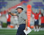 Ole Miss coach Houston Nutt signals at Vaught-Hemingway Stadium in Oxford, Miss. on Saturday, August 13, 2011. (AP Photo/Oxford Eagle, Bruce Newman)