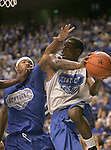 The Wildcats split up into two teams, blue and white, to scrimmage at Rupp Arena Wednesday night..Photo by Zach Brake | Staff