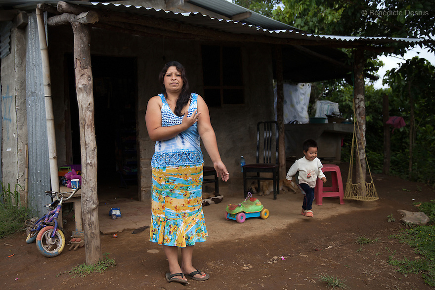 Blanca Delmi Ordóñez with her 3 year old son at their home in Teotepeque, La Libertad, El Salvador on June 9, 2015. Ordóñez gave birth in a latrine and she had not even known she was pregnant, although she already had a son. The baby was found dead in the latrine by firemen and authorities decided that this was murder. Ordóñez spent 11 months in prison. The case against her was finally dismissed. Abortion in El Salvador is illegal. The law formerly permitted an abortion to be performed under some limited circumstances, but, in 1998, all exceptions were removed when a new abortion law went into effect. Photo by Bénédicte Desrus