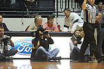 "Archie Manning (left), Eli Manning (center) and Ole Miss football coach Hugh Freeze talk at  at the C.M. ""Tad"" Smith Coliseum in Oxford, Miss. on Saturday, January 19, 2013. Mississippi won 76-64. (AP Photo/Oxford Eagle, Bruce Newman)"