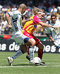 UNAM Pumas defender Dario Veron (L) fights for the ball with UAG Tecos forward Carlos David Casartelli during their soccer match March 19, 2006 at the University Stadium in Mexico City. UAG Tecos won 1-0 to UNAM Pumas. Photo by © Javier Rodriguez