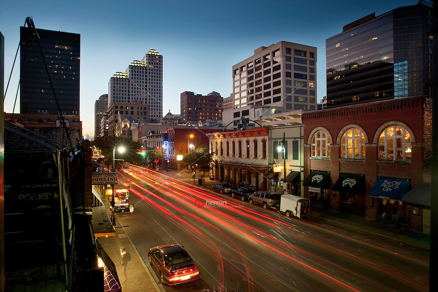 evening falls on the 6th street bar district in downtown. Black Bedroom Furniture Sets. Home Design Ideas